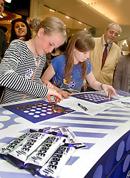"""Cadburys Spots vs Stripes Challenge Race Season Meadowhall Sheffiel.competeing for """"Fastest Doodler"""" Katie Hawkridge and Megan King both aged 10 from Barnsley.2 April 2011.Images © Paul David Drabble"""