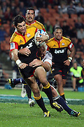 Stephen Donald gets tackled by Stormers Captain Schalk Burger during the Investec Super 15 Rugby match, Chiefs v Stormers, at Waikato Stadium, Hamilton, New Zealand, Saturday 14 May 2011. Photo: Dion Mellow/photosport.co.nz