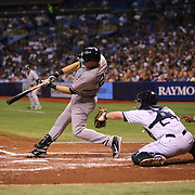 New York Yankees first baseman Mark Teixeira (25) hits the ball during a major league baseball game between the New York Yankees and the Tampa Bay Rays at Tropicana Field on Thursday, Sept. 17, 2014 in St. Petersburg, Florida. The Yankees won the game 3-2 and this was Jeter's last game against Tampa Bay. (AP Photo/Alex Menendez)