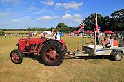 Vintage David Brown tractor giving rides, Sweffling village summer fete, Suffolk, England, UK
