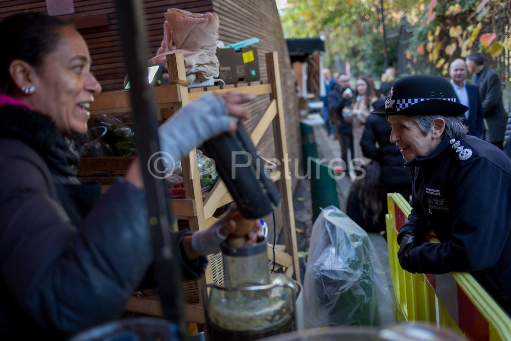 The morning after the terrorist attack at Fishmongers Hall on London Bridge, in which Usman Khan a convicted, freed terrorist killed 2 during a knife a attack, then subsequently tackled by passers-by and shot by armed police - Met Police Commissioner Cressida Dick tours Borough Market to speak with stall holders and officers, on 30th November 2019, in London, England.