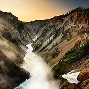 The lower falls of the Yellowstone River flows towards the Grand Canyon of the Yellowstone in Yellowstone National Park Wyoming.