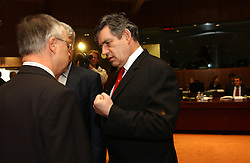 BRUSSELS, BELGIUM - MARCH-08-2005 - Gordon Brown, the UK's finance minister, right, speaks with colleagues during the ECOFIN conference, a meeting of  European Union finance and economic ministers, in Brussels.