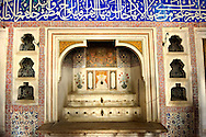 The Ottoman architecture of the fountain in the Privy Chamber of Sultan Murad III decorated with 16th century Iznk tiles. Topkapi Palace, Istanbul, Turkey .<br /> <br /> If you prefer to buy from our ALAMY PHOTO LIBRARY  Collection visit : https://www.alamy.com/portfolio/paul-williams-funkystock/topkapi-palace-istanbul.html<br /> <br /> Visit our TURKEY PHOTO COLLECTIONS for more photos to download or buy as wall art prints https://funkystock.photoshelter.com/gallery-collection/3f-Pictures-of-Turkey-Turkey-Photos-Images-Fotos/C0000U.hJWkZxAbg