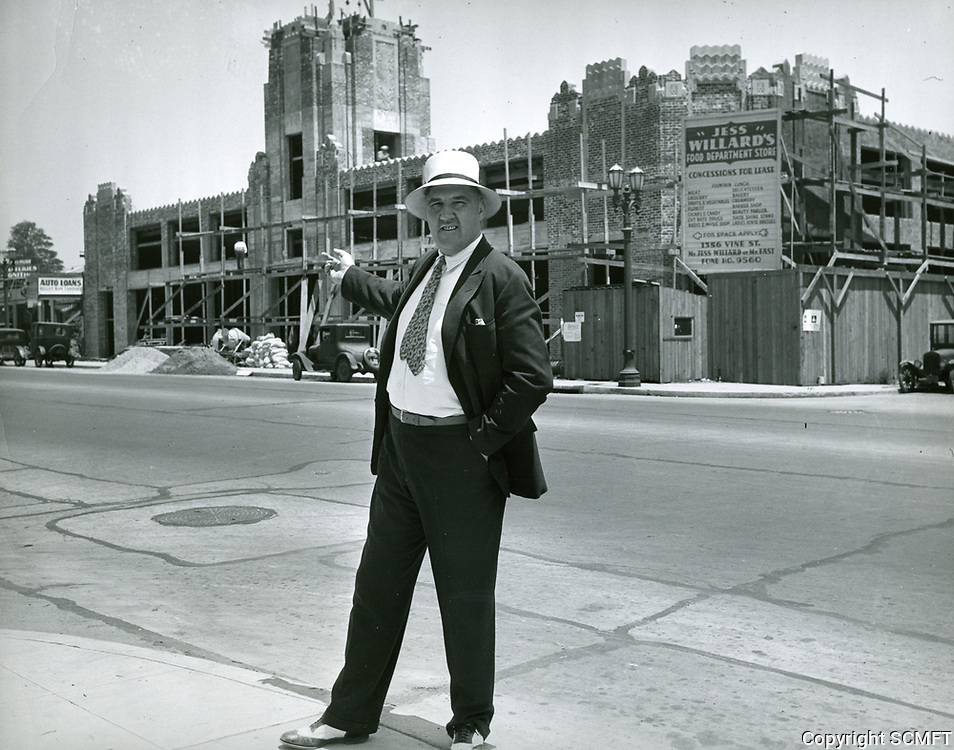 1931 Jess Willard points to the construction of his grocery store at 1334 Vine St.
