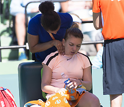 March 22, 2018 - Miami, FL, United States - Miami, FL - March, 22: Simona Halep (ROU) gets some medical attention before defeating Oceane Dodin (FRA) 36 63 75 at the 2017 Miami Open held at the Tennis Center at Crandon Park.   Credit: Andrew Patron/Zuma Wire (Credit Image: © Andrew Patron via ZUMA Wire)