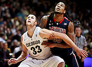 SHOT 1/21/12 5:44:36 PM - Colorado's Austin Dufault #33 battles for position under the basket with Arizona's Jesse Perry #33 during their PAC 12 regular season men's basketball game at the Coors Events Center in Boulder, Co. Colorado won the game 64-63..(Photo by Marc Piscotty / © 2012)