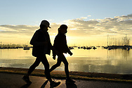 An a pair of walkers getting their 2 hours of exercise on the foreshore of Williamstown as the sunrises across the bay over Melbourne on the 7th day the state wide COVID-19 lockdown that has been placed on the State of Victoria. (Photo by Michael Currie/Speed Media)