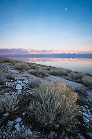 Sunset illuminates the mountains of Northern Utah as the last bit of light fades away over the Great Salt Lake as seen from Antelope Island.