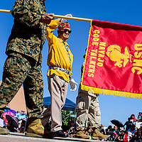 Navajo Code Talker Thomas Begay marches with a Marine Corps escort in the Gallup Intertribal Indian Ceremonial Parade in downtown Gallup Saturday.