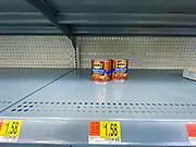 """15 MARCH 2020 - ANKENY, IOWA: Vegetarian baked beans are the only thing left on a canned goods shelf in the Walmart store in Ankeny. Iowans started hoarding paper products and canned goods over the weekend as fears of coronavirus caused shortages spread. The Governor of Iowa announced Saturday night that the Coronavirus in Iowa had entered the """"community spread"""" phase when a person in Dallas County, in the Des Moines metropolitan area, tested positive for Coronavirus. As of Sunday morning, Iowa was reporting 18 people tested positive for Coronavirus.                      PHOTO BY JACK KURTZ"""