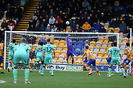 Mansfield Town goalkeeper Bobby Olejnik (12) tips over a shot  during the EFL Sky Bet League 2 match between Mansfield Town and Carlisle United at the One Call Stadium, Mansfield, England on 1 February 2020.