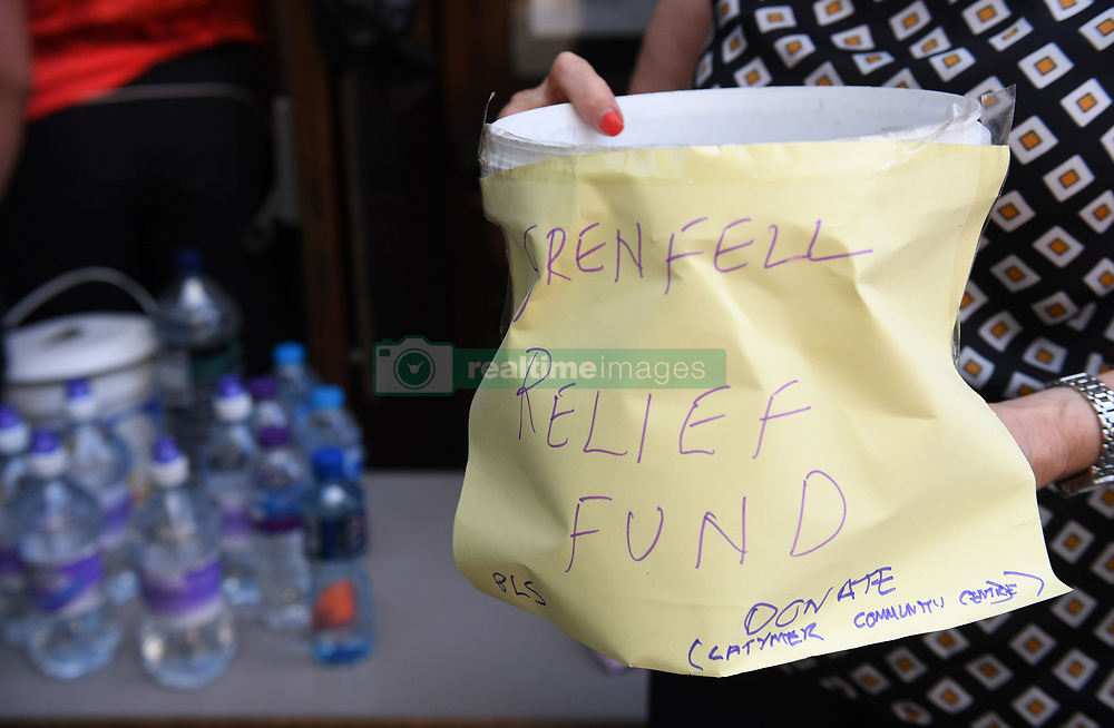 A relief fund bucket set up by local residents for those caught up in a fire that engulfed the 24-storey Grenfell Tower in west London.