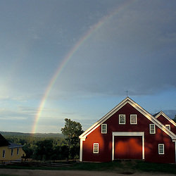 New Gloucester, ME..A rainbow arcs over  the barn at the Sabbathday Lake Shaker Village.