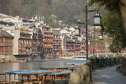 View of traditional Chinese style houses along the riverbank in an old town, Fenghuang, Hunan Province, China