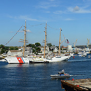 The U.S. Coast Guard Eagle sails into Portsmouth Harbor on August 2, 2013, to participate in Sail Portsmouth, hosted by the Piscataqua Maritime Commission. Badgers Island and the Portsmouth Naval Shipyard are in the background.