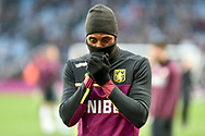 Aston Villa striker Jonathan Kodjia (26) wrapped up against the the cold during the The FA Cup 3rd round match between Aston Villa and Swansea City at Villa Park, Birmingham, England on 5 January 2019.