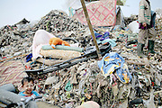 Mae Sot, Tak, Thailand - <br /> <br /> 'City Of Garbage' In Thailand<br /> <br /> Burmese refugees and garbage collectors living and working in the garbage dump site in Mae Sot, Tak, Thailand on the Thai Burma border. Tingkaya, also known as the City Of Garbage, is an area roughly the size of a football stadium. The poor inhabitants make a living selling recyclable materials like wire, metal, glass, plastic. The heap dwellers survive by eating left-overs and sleep in the same harsh environment which is a breeding ground for bacteria and diseases.<br /> ©Exclusivepix