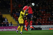 York City defender Kennedy Digie (4) wins an aerial dual during the Vanarama National League match between York City and Chester FC at Bootham Crescent, York, England on 13 November 2018.