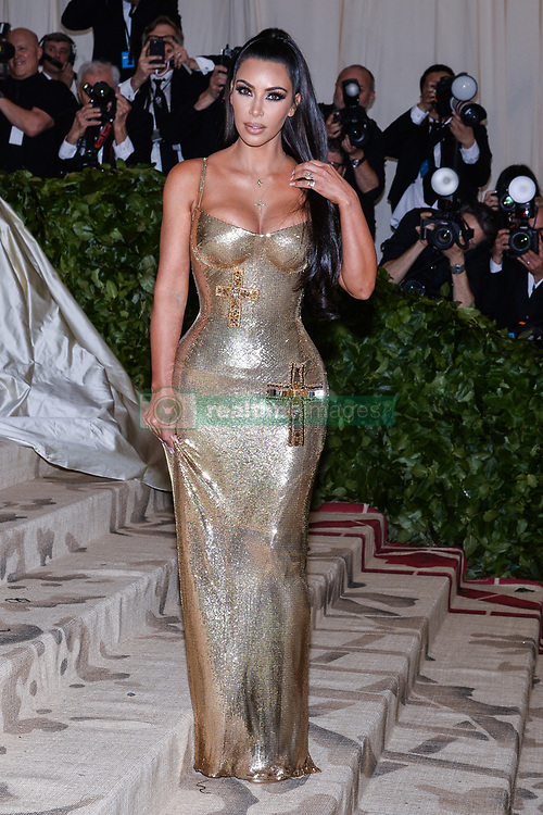 Kim Kardashian West walking the red carpet at The Metropolitan Museum of Art Costume Institute Benefit celebrating the opening of Heavenly Bodies : Fashion and the Catholic Imagination held at The Metropolitan Museum of Art  in New York, NY, on May 7, 2018. (Photo by Anthony Behar/Sipa USA)