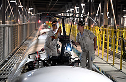 ZHENGZHOU, Sept. 7, 2016 (Xinhua) -- Mechanics check a CRH high-speed train at a maintenance center in Zhengzhou, capital of central China's Henan Province, Sept. 6, 2016. (Xinhua/Li An) (wf) (Credit Image: © Li An/Xinhua via ZUMA Wire)