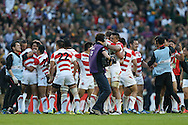 Japan players celebrate during the Rugby World Cup Pool B match between South Africa and Japan at the Community Stadium, Brighton and Hove, England on 19 September 2015. Photo by Phil Duncan.