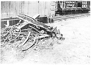 Coupler and bolster with other metal pieces.  A small junkpile.  In the background are a partially visible boxcar and stock car #5728.<br /> D&RGW