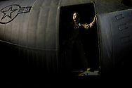 Airman First Class Sandra Brazell prepares for a leaflet drop over Iraq with her C-130 aircraft on Mar. 31, 2008.