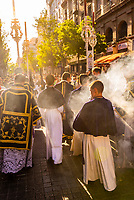 Smoke from lantern of frankincense, Procession of Brotherhood (Hermandad) de San Benito, Holy Week (Semana Santa), Seville, Andalusia, Spain.