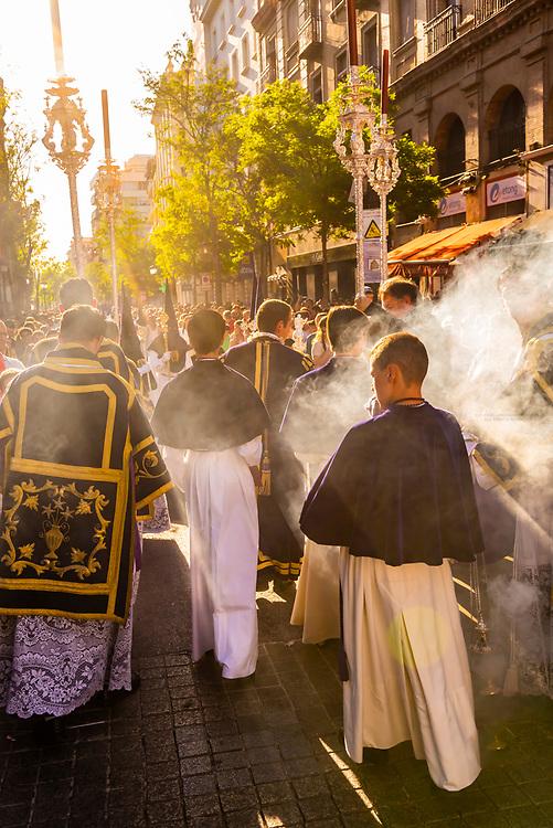 Smoke from lantern of frankincense, Procession of Brotherhood (Hermandad) de San Benito, Holy Week (Semana Santa), Seville, Andalusia, Spain.
