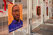 02 APRIL 2021 - MINNEAPOLIS, MINNESOTA: Pictures of Black people killed by police on a perimeter fence around the Hennepin County Courthouse. Protesters are keeping a 24 hour presence in front of the Hennepin County Courthouse in Minneapolis during the murder trial of former Minneapolis Police Officer Derek Chauvin. Chauvin is on trial for murdering George Floyd in 2020. Floyd's death, while restrained and in police custody, set off a summer of racial justice protests across the United States.       PHOTO BY JACK KURTZ
