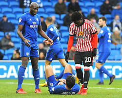Josh Maja of Sunderland helps up Sean Morrison of Cardiff City - Mandatory by-line: Nizaam Jones/JMP- 13/01/2018 -  FOOTBALL - Cardiff City Stadium - Cardiff, Wales -  Cardiff City v Sunderland - Sky Bet Championship
