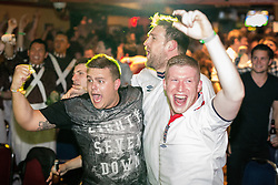 © Licensed to London News Pictures . 14/06/2014 .  Manchester , UK . England fans celebrate after equalising against Italy . Football fans watch the England vs Italy World Cup tie at Walkabout in Manchester City Centre this evening (Saturday 14th June 2014) as England play Italy in their first match of the 2014 World Cup , in Brazil . Photo credit : Joel Goodman/LNP