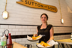 Manager Arianna Bonesso serves up plates of vegan scampi and 'fish' and chips at London's first totally vegan chippy in Hackney, North East London. Hackney, London, October 08 2018.