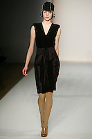 Laura Kaeding walks the runway wearing Karen Walker Fall 2009 Collection