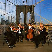 Tokyo String Quartet atop the Brooklyn Bridge in Manhattan.