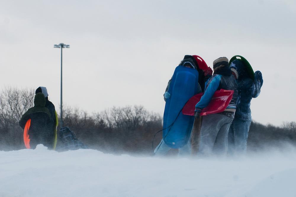 Matt Dixon   The Flint Journal..Sledders shield themselves from the stiff winds at Flint Southwestern Academy, Wednesday, Feb. 2.
