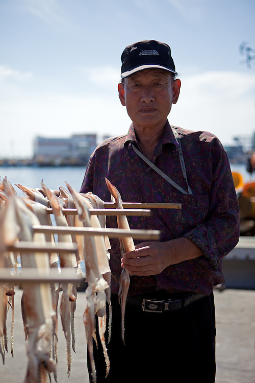 Portrait of the korean cuttlefish seller in the harbour / Jukbeon, South Korea, Republic of Korea, KOR, 05 October 2009.