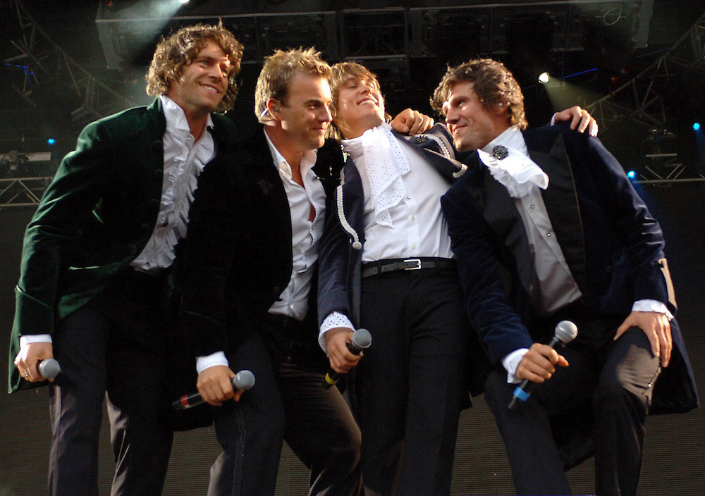 TAKE THAT performing in concert at the Milton Keynes Bowl, Milton Keynes. L TO R Howard Donald, Gary Barlow, Mark Owen and Jason Orange<br /> <br /> Code - 343277<br /> <br /> www.expresspictures.com<br /> Express Syndication<br /> +44 870 211 7661/2764/7903/7884/7906