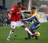 Photo: Paul Thomas.<br /> Mansfield Town v Walsall. Coca Cola League 2. 20/01/2007.<br /> <br /> Walsall's Mark Wright (L) looses the ball to Gareth Jelleyman.