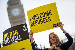 "© Licensed to London News Pictures. 16/03/2017. London, UK. Activists from Amnesty International UK hold a ""flashmob"" demonstration in Westminster today, protesting against Donald Trump's travel ban executive order. Yesterday, a federal judge in Hawaii blocked President Donald Trump's travel ban, shortly before it was to be put in place. Photo credit : Tom Nicholson/LNP"