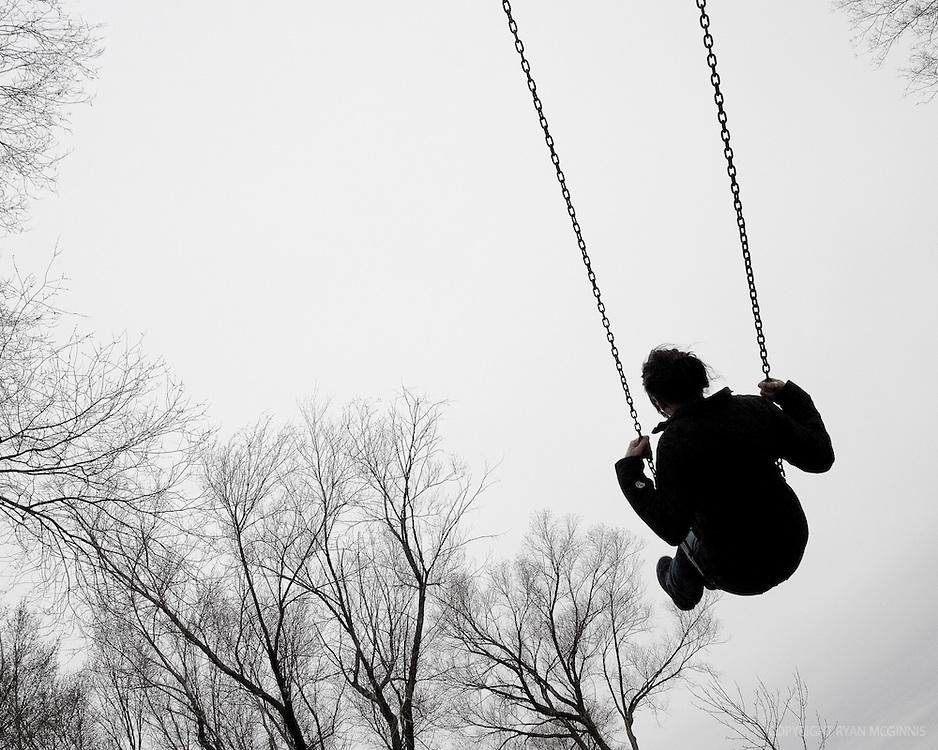 A woman swings, 2006.
