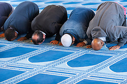 © Licensed to London News Pictures. 05/02/2017. London, UK. Men praying during an open day held at the Central London Mosque near Regent's Park.  Over 150 mosques across the UK have been encouraged to hold mosque open days as part of Visit My Mosque Day, a national initiative facilitated by the Muslim Council of Britain (MCB), showcasing how mosques are not only spiritual focal points, but also servants to their localities helping people of all faiths and none by running food banks, feed-the-homeless projects, neighbourhood street cleans, local fundraising and more. Photo credit : Stephen Chung/LNP