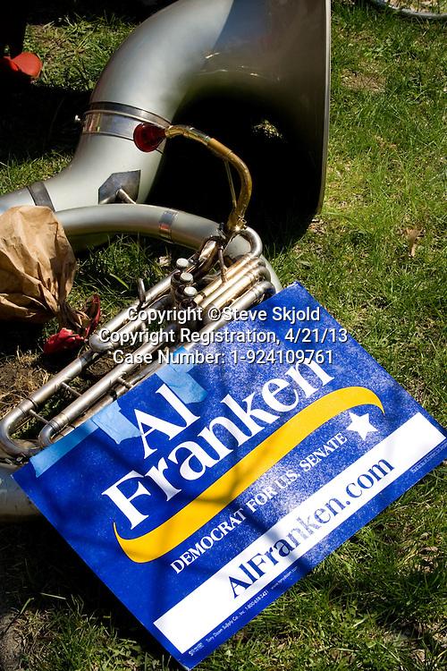 Al Franken USA Senator campaign poster attached to tuba.  MayDay Parade and Festival Minneapolis Minnesota MN USA