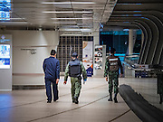 17 AUGUST 2015 - BANGKOK, THAILAND:         Thai soldiers walk through elevated walkway near Chit Lom BTS station after the walkway was shut down following an explosion at the Erawan Shrine, which is next to the walkway. An explosion at Erawan Shrine, a popular tourist attraction and important religious shrine, in the heart of the Bangkok shopping district killed at least 19 people and injured more than 120 others, mostly foreign tourists, during the Monday evening rush hour. Twelve of the dead were killed at the scene. Thai police said an Improvised Explosive Device (IED) was detonated at 18.55. Police said the bomb was made of more than six pounds of TNT stuffed in a pipe and wrapped with white cloth. Its destructive radius was estimated at 100 meters. The Bangkok government announced that public schools would be closed Tuesday as a precaution.   PHOTO BY JACK KURTZ