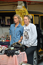 Left to right, LAURA BAILEY and BAY GARNETT at #SheInspiresMe Car Boot Sale in Aid of Women for Women International held at the Brewer Street Carpark, Soho, London on 23rd April 2016.