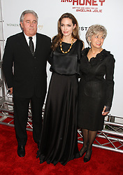 Dec. 5, 2011 - New York, NY, U.S - Angelina Jolie with Brad Pitt's Parents, Bill Pitt and Jane Pitt at 'In The Land Of Blood And Honey' New York Premiere which took place at the Chelsea West Cinema. (Credit Image: © Dan Herrick/ZUMAPRESS.com)