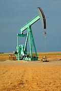 Oil pump jack and peas<br /> Arcola<br /> Saskatchewan<br /> Canada