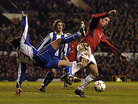 Photo. Jed Wee.<br /> Manchester United v FC Porto, UEFA Champions League, Old Trafford, Manchester. 09/03/2004.<br /> Manchester United's Ruud van Nistelrooy (R) creates confusion in the Porto penalty area as Porto's Pedro Emanuel is upended.