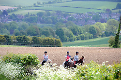 © Licensed to London News Pictures. 21/05/2015<br /> Sunny weather Kent.<br /> Three women enjoying a sunny afternoon horse riding in fields near Crockenhill Lane,Crockenhill,Kent. <br /> <br />  <br /> (Byline:Grant Falvey/LNP)